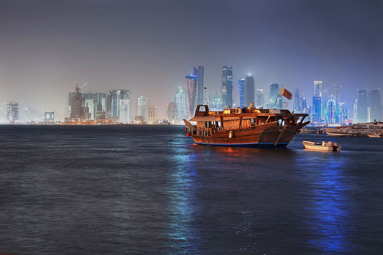 Doha skyline from the water by night