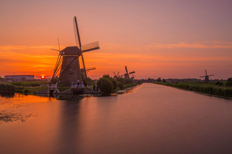 Sunset over the windmills at Kinderdijk - One of Holland's World Heritage Sites