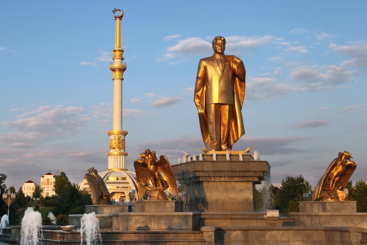 Monumen of Niyazov and Arch of Independence in sunset, Ashkhabad, Turkmenistan