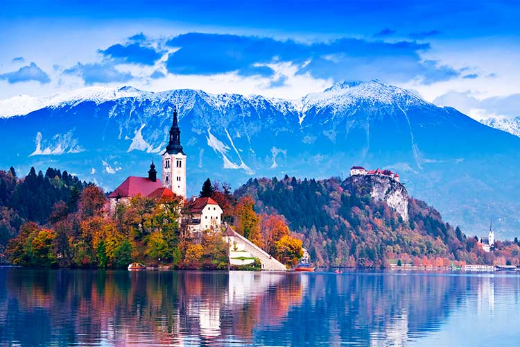 Bled with lake, island, castle and mountains in background, Slovenia