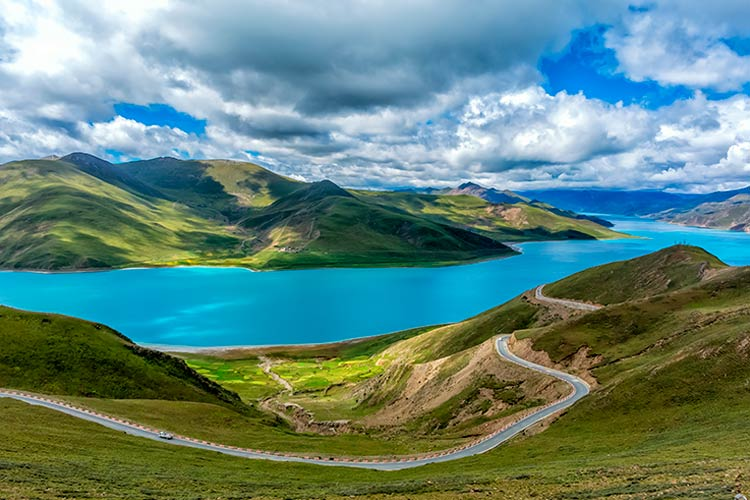 The Yamdrok Lake under the sunny blue sky in Tibet
