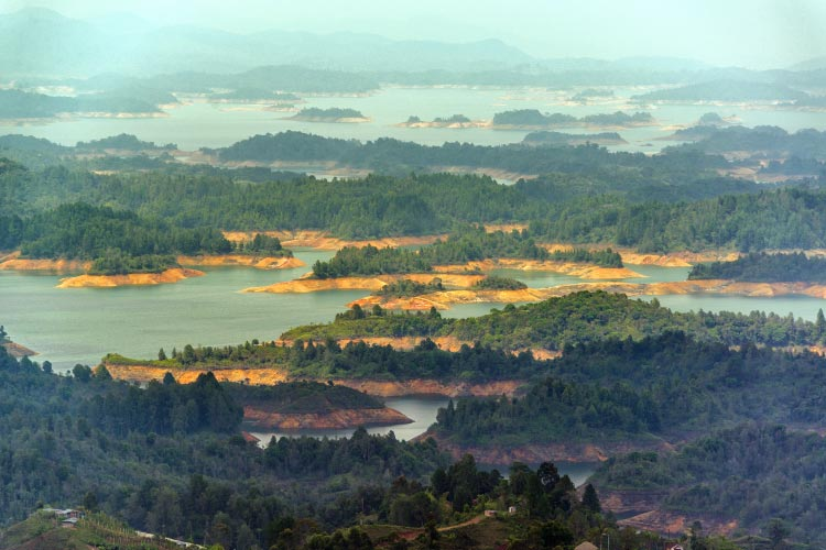 Beautiful lake at Guatape with a series of forested islands in it in Antioquia