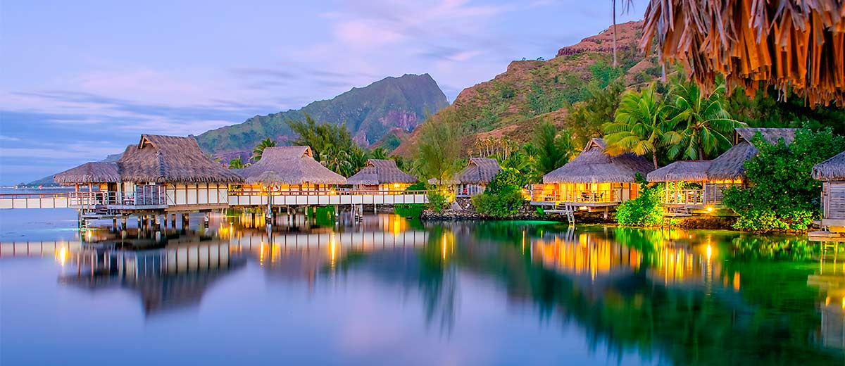 Overwater Bungalows at dusk in Moorea