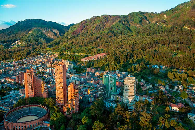 A view of the center of Bogota with the Andes in the background