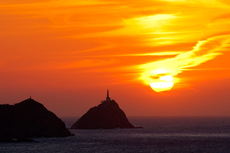Lighthouse at sunset, Caribbean coast of Taganga, Colombia