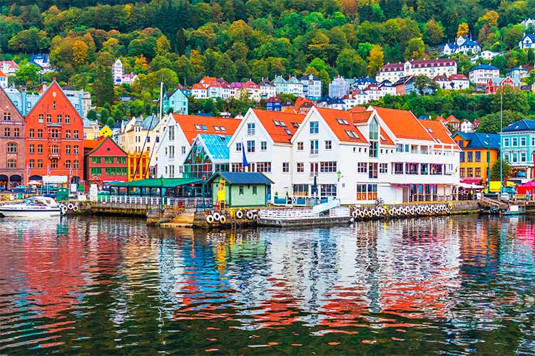 Scenic summer panorama of the Old Town pier architecture of Bryggen in Bergen