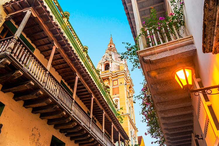 historic colonial balconies and a church in Cartagena, Colombia