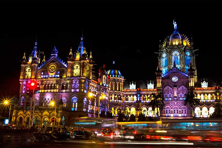Chhatrapati Shivaji Terminus (Victoria Terminus) illuminated with multi-colored lights in the evening during Diwali Festival