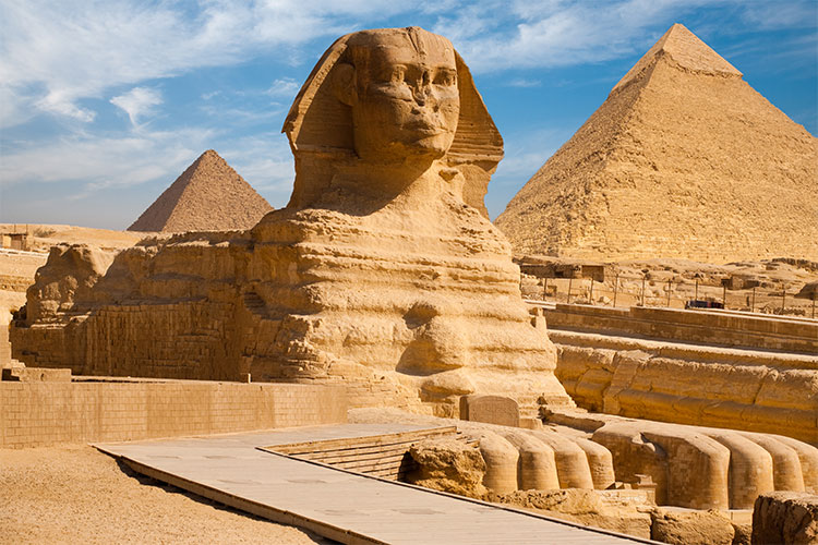 Great Sphinx including pyramids of Menkaure and Khafre in the background