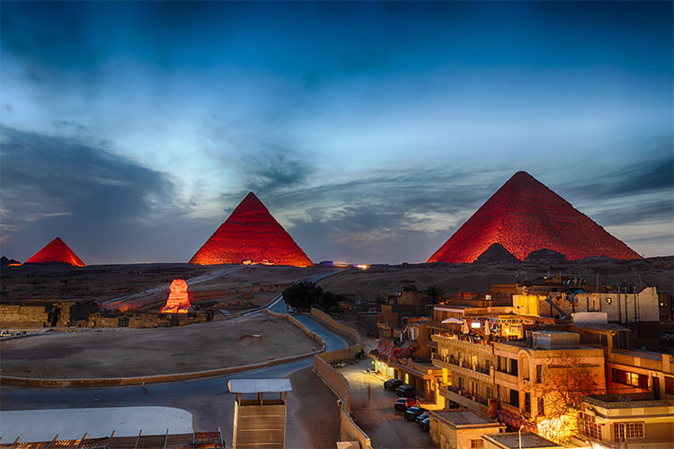 The Pyramids at night, view from Giza buildings, Egypt