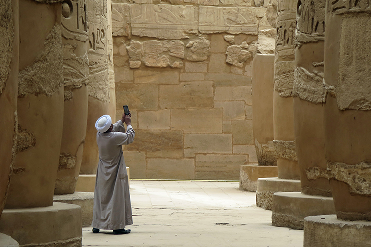Man taking photos inside Karnak Temple Complex in downtown Luxor