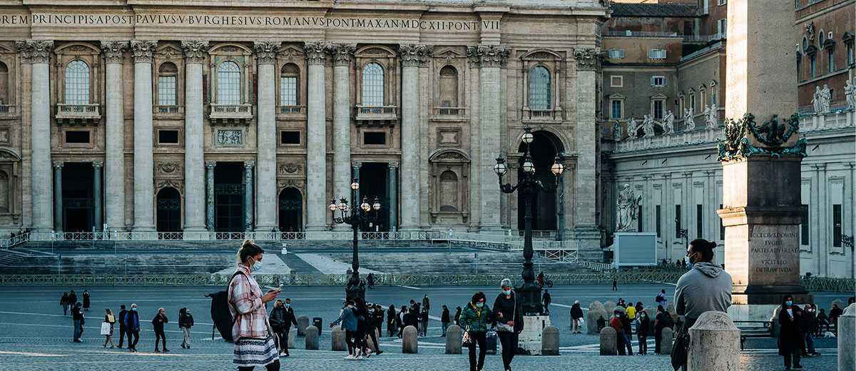 Tourists in St Peter's Square in the Vatican, wearing face masks